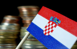 Croatian flag waving with stack of money coins Royalty Free Stock Photography