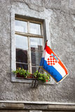 Croatian flag in the window of old house in Zagreb, Croatia Stock Photos