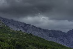 Croatian forest with clouds in mountains - Brela, Makarska Riviera, Croatia. Croatian forest with clouds in mountains near Brela, Makarska Riviera, Croatia stock photos