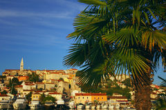 Croatian harbour in front of a village on a hill Stock Images