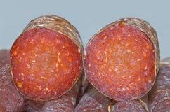 Croatian Kulen Sausage. Cross Section of Croatian Smoked Dry Pork Meat Sausage, Kulen royalty free stock image