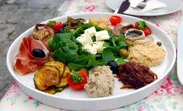 Croatian Meze Lunch. Consisting of Local Feta Cheese, Humus, Tuna Salad, Pickled Mackerel, Parma Ham, Marinated Eggplant and Onion Relish royalty free stock photo