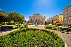 Croatian national theater in Rijeka square view. Fountain and architecture, Kvarner bay, Croatia Stock Image