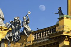 Croatian national theater in Zagreb, Croatia. Statues on the roof of Croatian national theater in Zagreb, Croatia, with a gibbous Moon in the sky Stock Photography