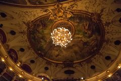 Croatian National Theatre ceiling. ZAGREB, CROATIA - October 14, 2014: Chandelier on the painted ceiling in Croatian National Theatre, a neo-baroque building, a Stock Photo