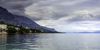 Croatian sea view with mountains in Brela, Makarska Riviera, Croatia. Croatian sea view with mountains, Brela, Makarska Riviera, Croatia stock image