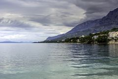Croatian sea view with mountains in Brela, Makarska Riviera, Croatia. Croatian sea view with mountains, Brela, Makarska Riviera, Croatia royalty free stock image