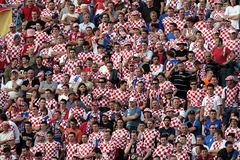 Croatian soccer fans. In their national red and white colors Stock Photos
