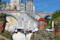 Croatian soldiers at millitary pilgrimage in Lourdes, France. Croatian soldiers prayng at millitary pilgrimage in Lourdes, France Stock Photography