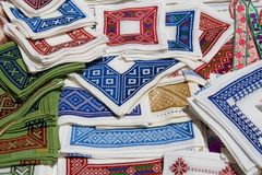Croatian Talbe Cloths. A varied set of Croatian cloth being sold as souvenirs to tourists stock images