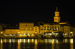 Croatian town at night. Town in Krk photographed from the harbor Royalty Free Stock Image