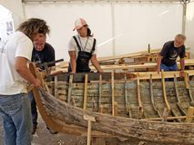 Croatian traditional shipbuilders are working on the restoration of an old wooden boat. Brest, France - July 12, 2008: Croatian traditional shipbuilders are Royalty Free Stock Photos