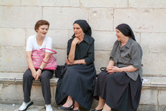 Croatian woman sitting and talking at Dubrovnik Stock Photos