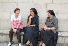 Croatian woman sitting and talking at Dubrovnik Stock Photos