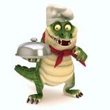Croc avec la cloche de nourriture Photo libre de droits