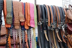 Croc Belts. A bunch of crocodile and alligator skin belts hang at Greenmarket, Cape Town, South Africa stock image