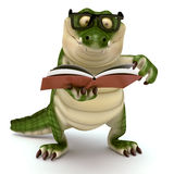 Croc reading book Royalty Free Stock Image