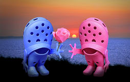 Croc shoe romance at sunset Royalty Free Stock Image