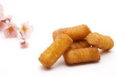 Crocchette con il fiore Immagini Stock