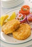Crocchette di pesci su una zolla Fotografie Stock Libere da Diritti