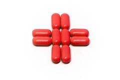 Croce rossa delle pillole Immagine Stock