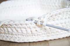 Crochet. Ing with thick white yarn Royalty Free Stock Photography