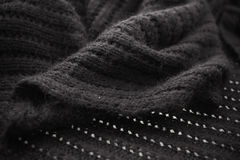 Crochet. Blac and gray background, shadow Royalty Free Stock Image