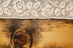 Crochet and aged wood background Royalty Free Stock Photo