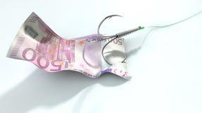 Crochet amorcé euro par billet de banque Images libres de droits
