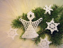 Crochet angel and snowflakes Stock Image