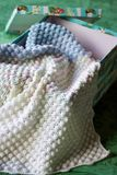 Crochet baby blanket in a box. Pastel colors for a crochet baby blanket in a box stock photography