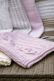Crochet Baby Blanket in Pink Closeup. Crochet, Cable Knit Baby Blanket on Sofa , Closeup Soft Focus High Contrast royalty free stock photography