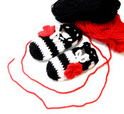 Crochet baby booties. Black, red and white crochet baby booties on white background Stock Photo