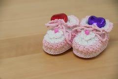 Crochet baby booties Stock Photo