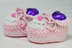 Crochet baby booties on white background Stock Photo