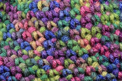 Crochet Background. Textured multi-colored stitches of crochet background Stock Image