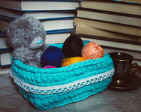 Crochet basket with balls of yarn and teddy bear Stock Photos
