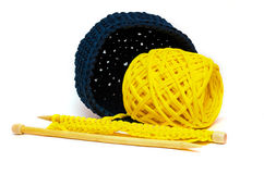 Crochet basket with yellow yarn and needles Royalty Free Stock Images