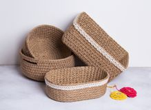 Crochet baskets on white background. Handmade baskets with lace for space optimization Royalty Free Stock Image