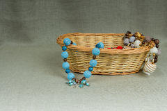 Crochet beads handmade in a wicker basket Royalty Free Stock Photography