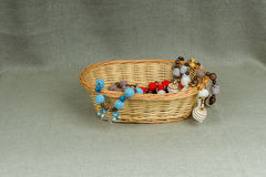 Crochet beads in a wicker basket Stock Photo