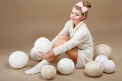 Crochet. Beautiful Needlewoman Sitting with Pile of White Skeins of Yarn. Needlecraft Royalty Free Stock Photos