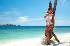 Crochet bikini. Beautiful woman wearing crochet bikini posing over the sea view, beach lifestyle Royalty Free Stock Photo