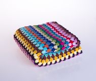 Crochet or crochet blanket on a background. Crochet or crochet blanket on a background royalty free stock images