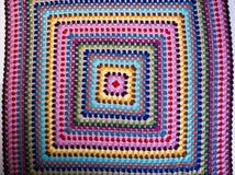 Crochet or crochet blanket on a background. Crochet or crochet blanket on a background royalty free stock photos