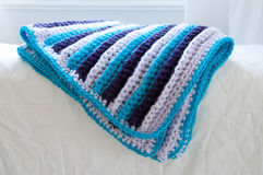 Crochet blanket. Handmade acrylic crochet blanket with 3 colors Stock Photo