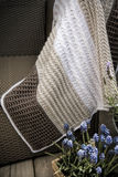 Crochet Cable Knit Baby Blanket in White Brown and Cream. Cable Knit Crochet Baby Blanket in White Brown and Cream on Sofa with Lavender, Soft Focus High royalty free stock images