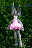 Crochet cat in the pink dress Stock Photos