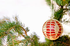 Crochet christmas ball. Red and golden christmas ball Royalty Free Stock Photography