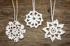Crochet christmas snowflakes Stock Photos